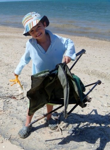 Beach Cleaning Volunteer near Cairns Port Douglas Great Barrier Reef Snapper Island