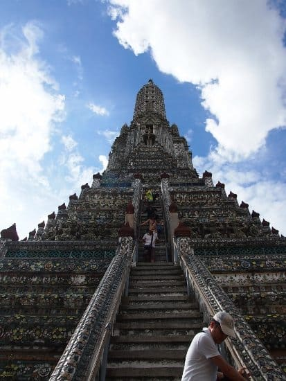 Climbing the prangs at wat arun