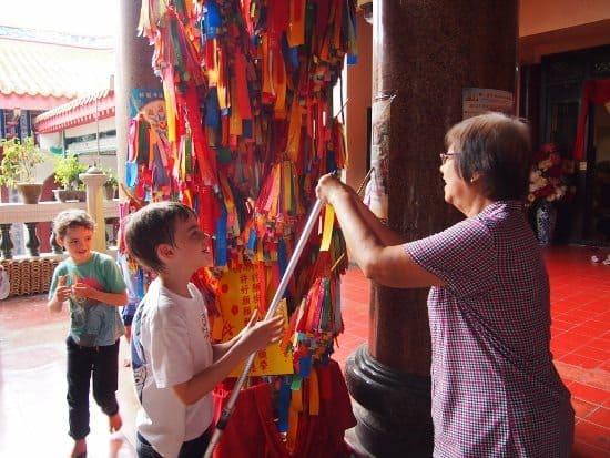 Kek Lok Si temple. Hanging a prayer.