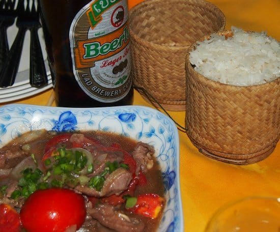 Laos curry with sticky rice and beer Lao. Food in Laos