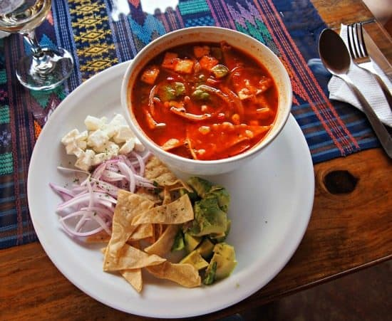 Where to eat in Antigua and Guatemalan food in antigua. Tortilla soup, typical of food in Antigua Guatemala.