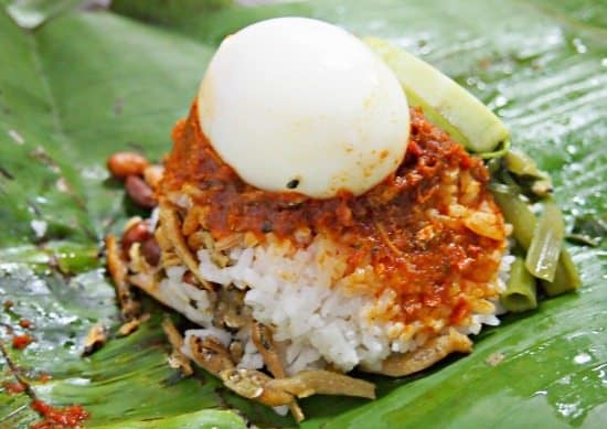 Nasi Lamak in Malaysia. Fat rice, with egg, anchovies peanuts and sambol