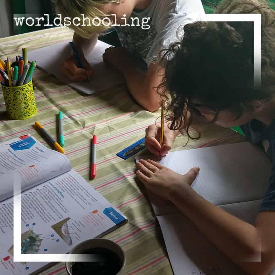 Worldschoolers doing written work. Curriculum