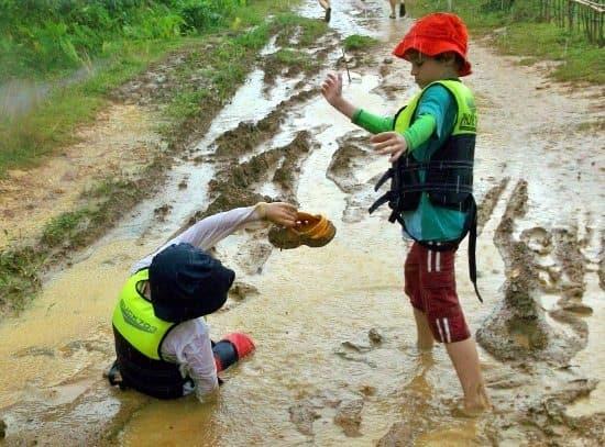 Mud on caving and kayaking tour vang vieng laos