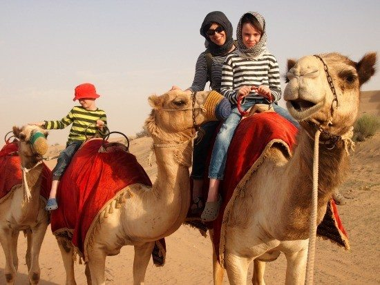 A Camel Safari in the desert. Dubai family fun travel.