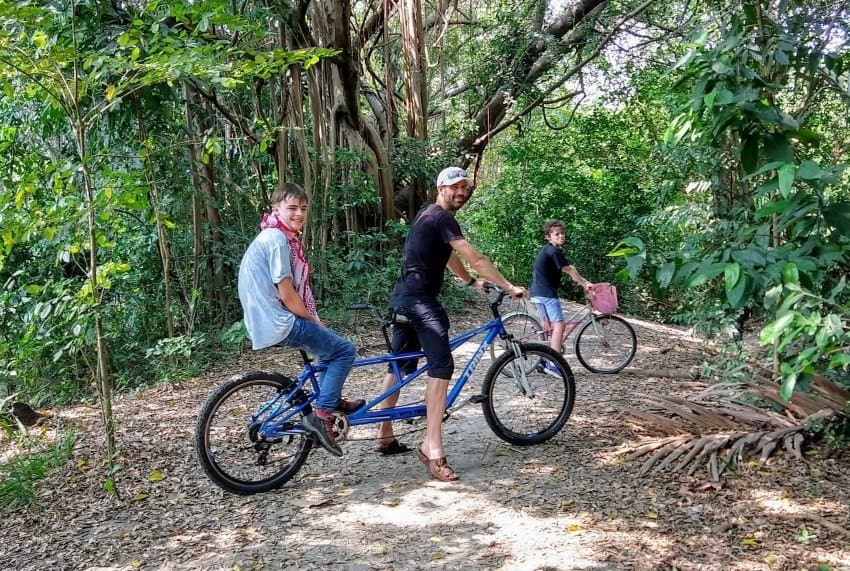 Family biking hiring or renting bikes and a tandem