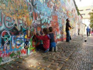 Tour of Prague with kids. The John Lennon Wall is a must see.
