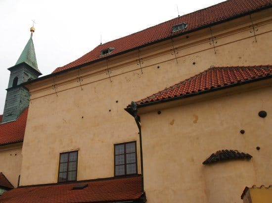 Highlights of Prague for kids. Cannonballs in the wall on a Prague Tour