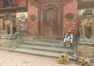 Entrails-The-Golden-Temple.-Lighting-Candles-Patan-Durbar-Square-Kathmandu-Nepal