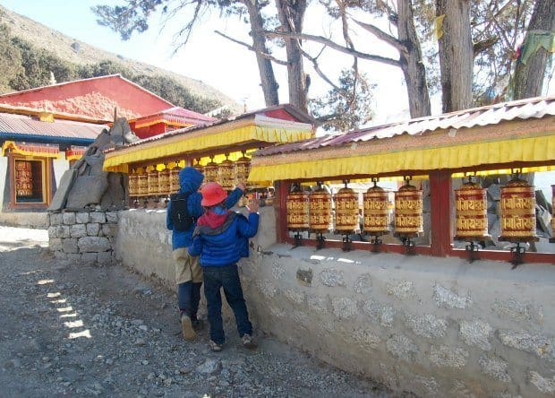 Khumjung Monastery trek, kids spinning prayer wheels