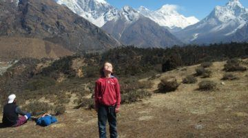 Staying fit while travelling walking. Child near Everest Nepal trek