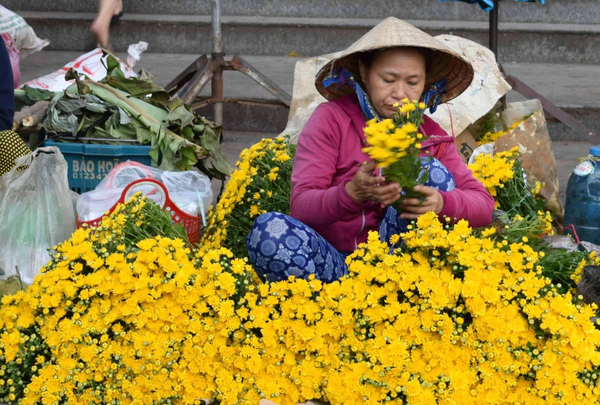 Selling flowers at Hoi An Market Vietnam