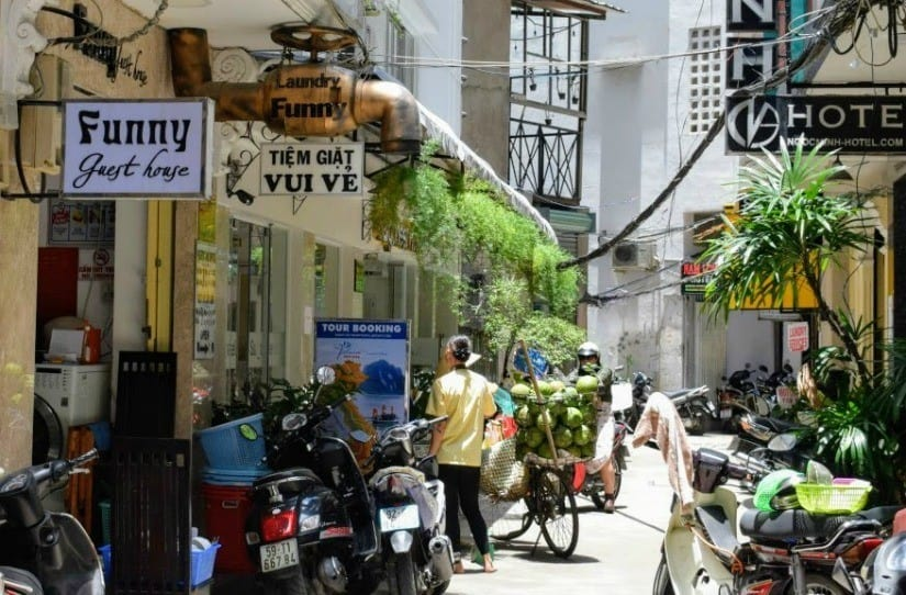 Family accommodation in south east asia, alleyway in saigon filled with hotels and guest houses