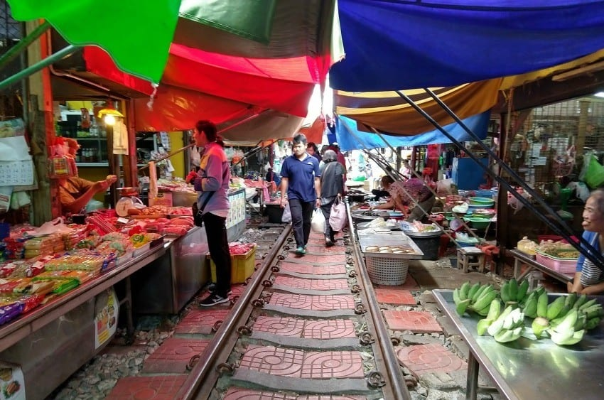 Maeklong Railway Market between trains
