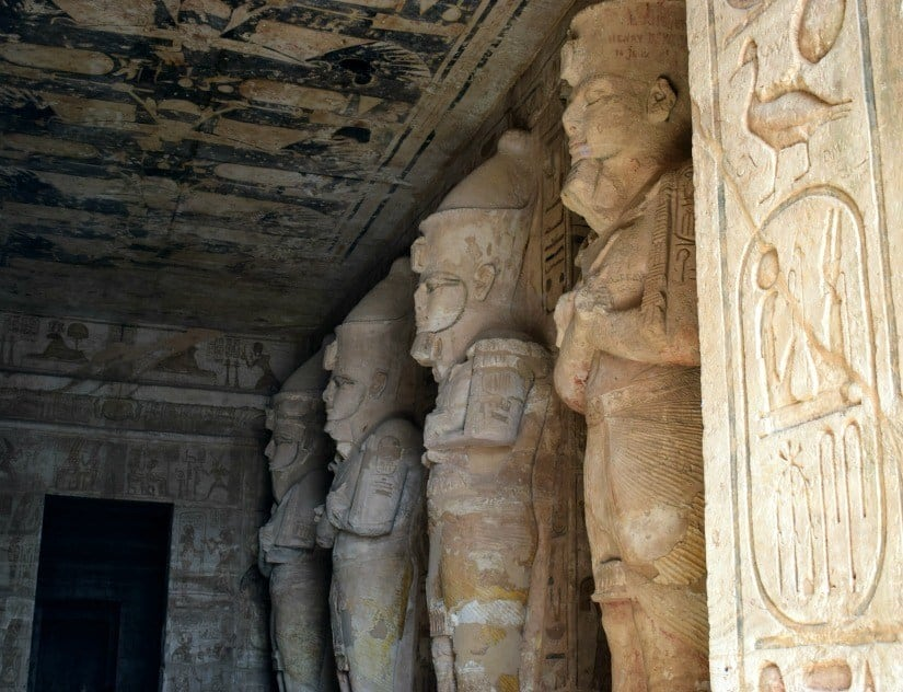 Abu Simbel statues of Rameses. Photograph of inside temple. Rameses statue is lit at dawn.