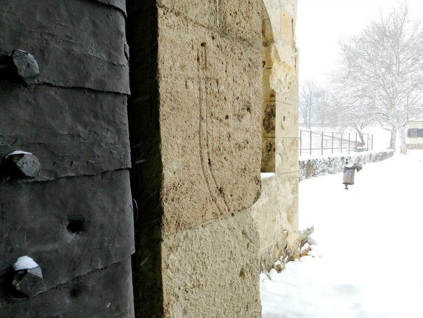 Belgrade Fortress Turkish Sword and Bullet Holes in the gate. Snow in Belgrade