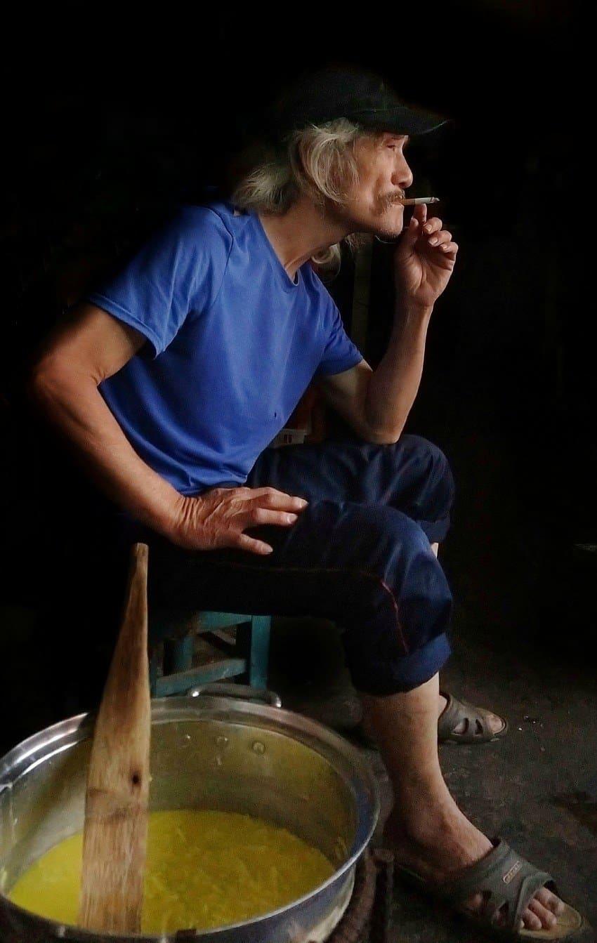 Vietnam best photo tour hoi an Photo of man smoking cigarette