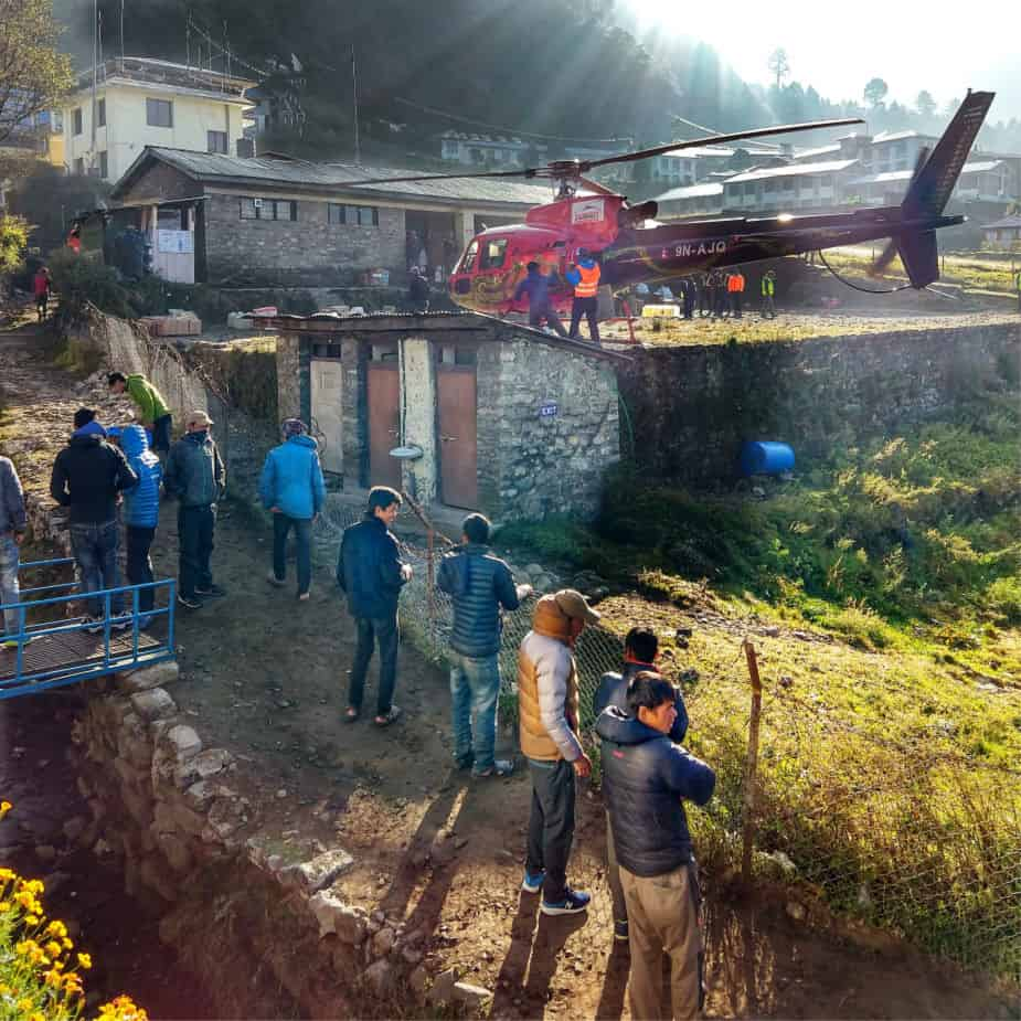 """尼泊尔卢克拉机场的直升飞机"""" class ="""" wp-image-36530"""" srcset ="""" https://worldtravelfamily.com/wp-content/uploads/2018/10/Helicopter-at-Lukla-Airport-Nepal.jpg 925w,https ://worldtravelfamily.com/wp-content/uploads/2018/10/Helicopter-at-Lukla-Airport-Nepal-150x150.jpg 150w,https://worldtravelfamily.com/wp-content/uploads/2018/10/ Helicopter-at-Lukla-Airport-Nepal-300x300.jpg 300w,https://worldtravelfamily.com/wp-content/uploads/2018/10/Helicopter-at-Lukla-Airport-Nepal-768x768.jpg 768w,https: //worldtravelfamily.com/wp-content/uploads/2018/10/Helicopter-at-Lukla-Airport-Nepal-100x100.jpg 100w"""" size =""""(max-width:925px)100vw,925px"""