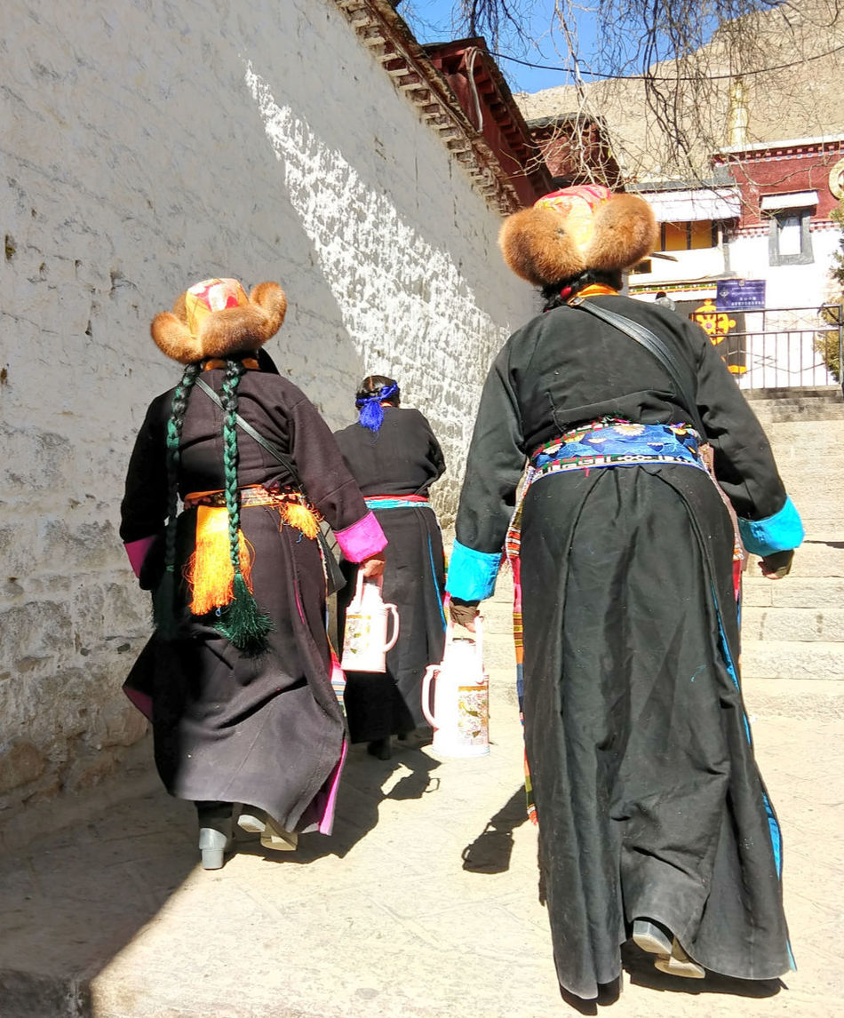 Women in traditional Tibetan costume at the Sera Monastery