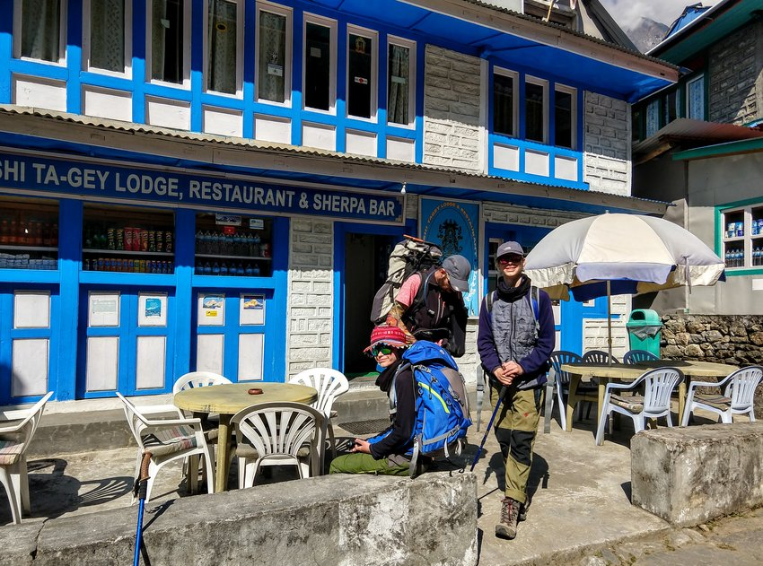trekkers outside a typical trekking lodge or tea house Nepal