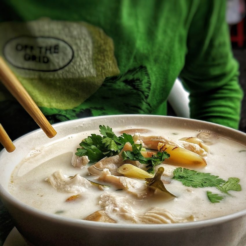 Eating Tom Kha Gai Thai cuisine tom ka gai chicken coconut soup
