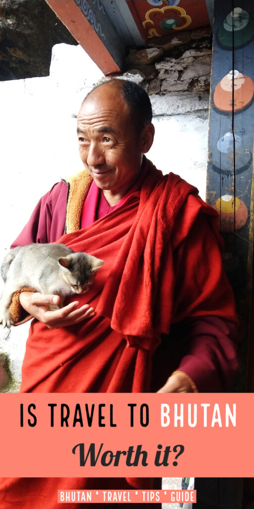 Travel to Bhutan Monk with kitten at Kila Goenpa Nunnery Chele la Gompa