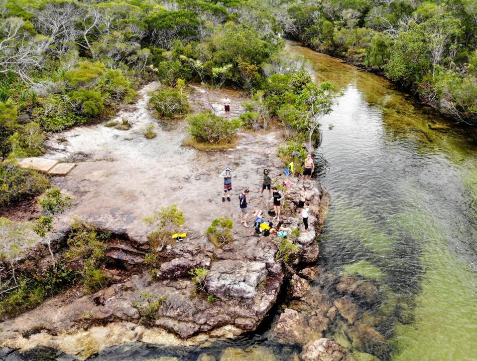 Travel with teenagers group tour flying a drone over fruitbat falls