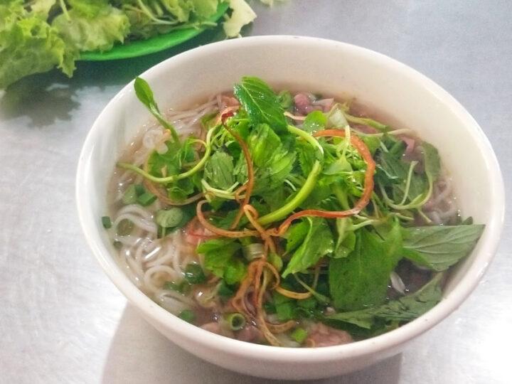 A bowl of Bun Bo Hue Beef Noodle Soup Served in Hue Vietnam