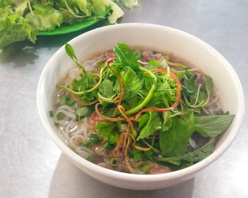 A bowl of Bun Bo Hue Beef Noodle Soup Served in Hue Vietnam