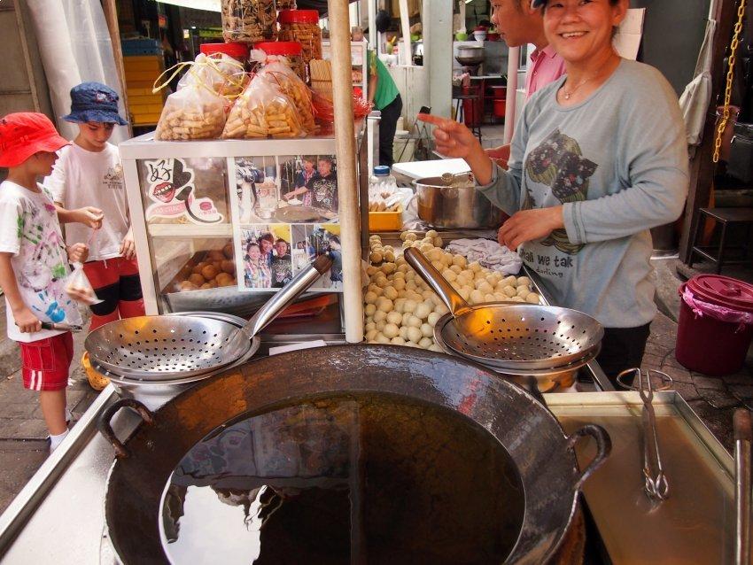 Children eating street food China Town Kuala Lumpur with Kids