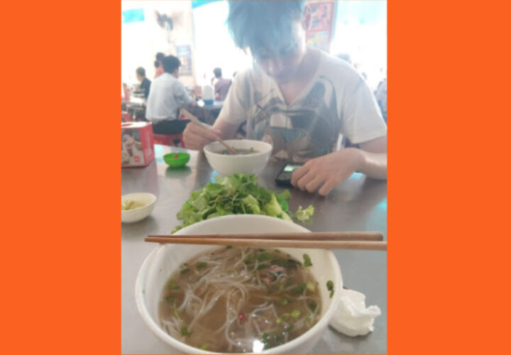 Eating Bun Bo Hue at a noodle shop in Hue City
