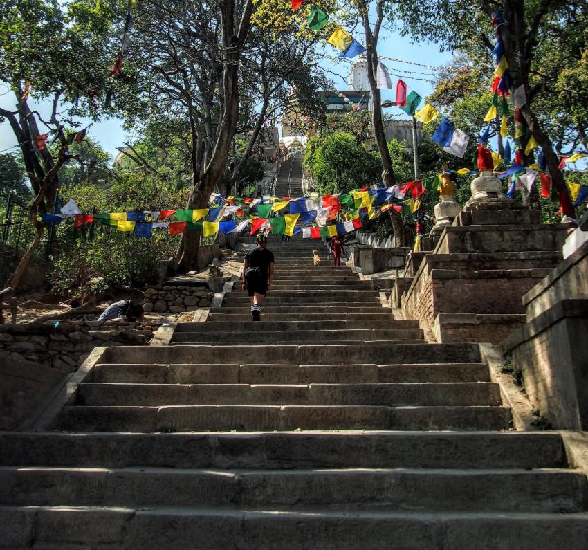 Climbing the Eastern Stairway graves and cemetary at swayambhunath stupa kathmandu