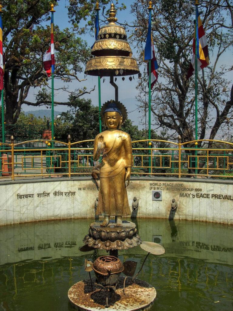 Golden buddha World Peace Pond Swayambhunath Kathmandu Nepal