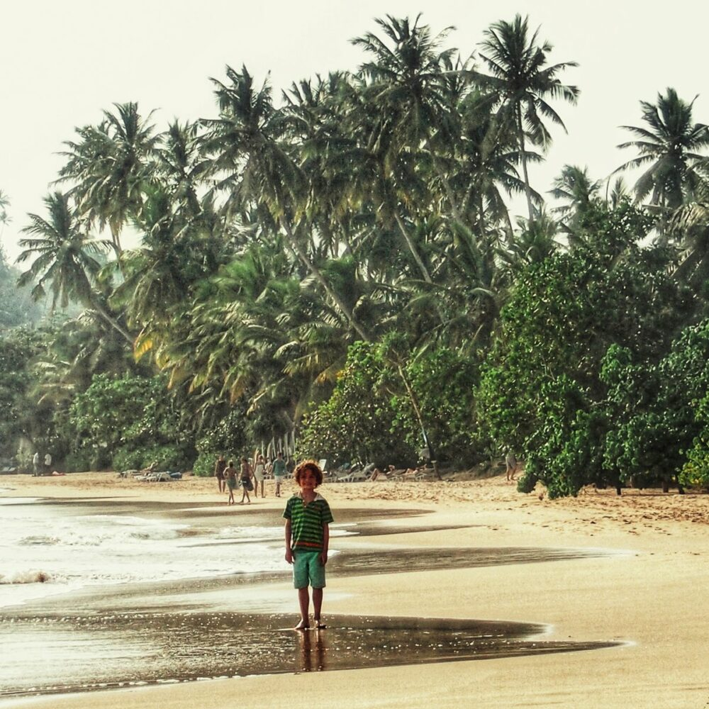 Child on a beach in Sri Lanka. Sri Lanka as a travel destination