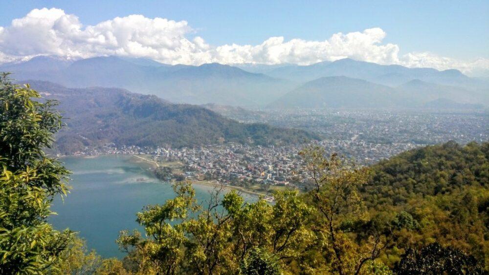 view of pokhara phewa lake and city  from peace pagoda