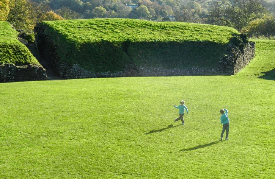 kids playing Roman Amphitheatre at Caerleon Wales