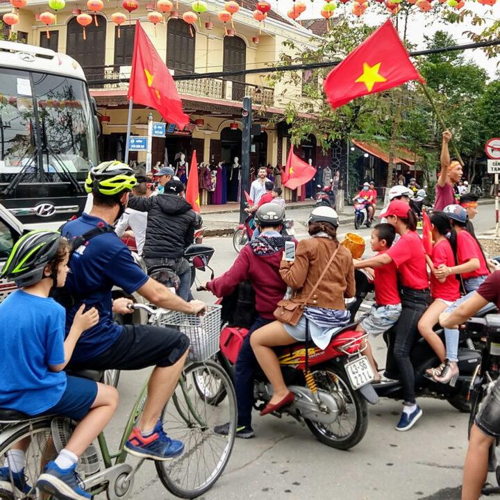 vietnam with kids. Street in Vietnam, tourist kid riding a bicycle.